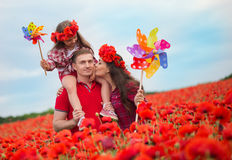 Family on the poppy field Royalty Free Stock Image