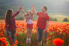 Family on the poppy field Stock Images