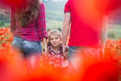 Family on the poppy field Stock Photo