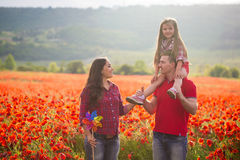 Family on the poppy field Stock Image