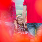 Family on the poppy field Stock Photography