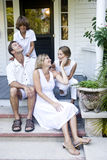 Family on porch steps. Family together on front porch steps of house Stock Image