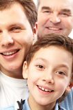 Family portrait. A vertical shot of three men belonging to different generations of the family Stock Image