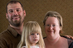 Family Portrait. A young family poses for family portraits in a studio Royalty Free Stock Image