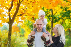 Family portrait against the background Indian summer. Stock Image