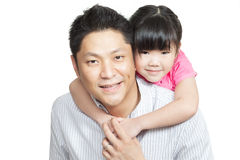 Family portrait of Asian Chinese father, daughter. Family portrait of young Chinese father piggybacking little daughter dressed in pink. Shot in studio, isolated Stock Photos