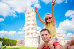 Family portrait background the Learning Tower in Pisa. Pisa - travel to famous places in Europe. stock photos