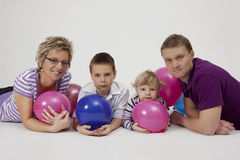 Family portrait with balloons. Happy family portrait at the studio with balloons Stock Photos