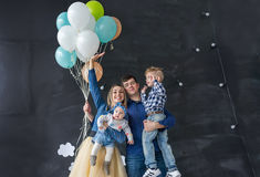 Family portrait with balloons in the studio. Concept of a happy family Royalty Free Stock Photo