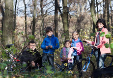 Family portrait with bicycles outdoors Royalty Free Stock Photography