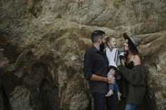 Family portrait with a big rock backdrop stock photo