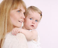 Family portrait of caring mother and her cute little baby girl Royalty Free Stock Photo