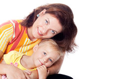 Family portrait of Caucasian mother with daughter. Family portrait showing a happy moment of fun between a caucasian mother with young daughter. isolated in Stock Photography