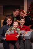 Family portrait at christmas. Portrait of happy family at christmas eve, holding presents, smiling Royalty Free Stock Photography