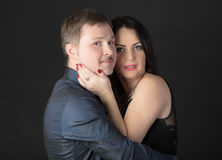 Family portrait. Portrait of a couple on a black background royalty free stock photography