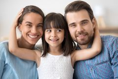 Family portrait of family with small kid hug posing stock images