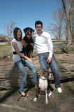 Family Portrait with Dogs. Happy married couple taking pictures with their dogs in the park royalty free stock image