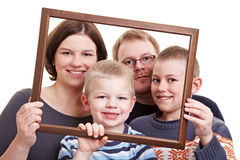 Family portrait with empty frame Royalty Free Stock Images