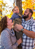 Family Portrait in the Fall adoring parents Stock Photo