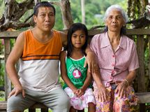 Family portrait of family in village of Kuching, Malaysia royalty free stock photography