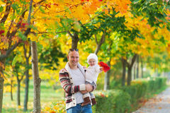 Family portrait of the father and daughter against the background  Indian summer. Stock Photo