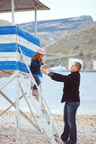Family. Portrait of father with his daughter on berth near sea in the city, still life photo stock photos