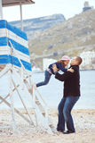 Family. Portrait of father with his daughter on berth near sea in the city, still life photo stock photo