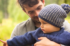 Family portrait. Father play with his child. Father holding a child in his arms. They are happy. Happy family walking outdoor stock images