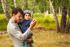 Family portrait. Father play with his child. Father holding a child in his arms. They are happy. Happy family walking outdoor. Photo Royalty Free Stock Images