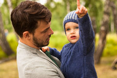 Family portrait. Father play with his child. Father holding a child in his arms. They are happy. Happy family walking outdoor. Photo Royalty Free Stock Photography