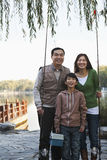 Family portrait with fishing gear at a lake Royalty Free Stock Photography