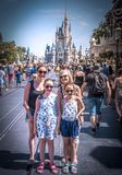 Family portrait Cinderella princess castle Main Street Disney world Florida. Family smiles main street Walt disney world Florida lovely blue sky Stock Photos