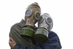 Family portrait in gas-masks royalty free stock images