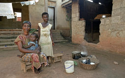 Family portrait of Ghanian mother and children. Ghana, Kumasi City: Group portrait of a proud Ghanaian mother and her daughters, children, cooking in the open Royalty Free Stock Photography