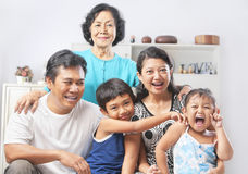 Family portrait with grandmother. Asian family portrait with their grandmother. PS: stitching image for the tightly crop area of grandma's head make additional Stock Photos