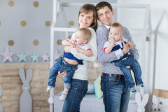 Family portrait of happy mom dad. And twins boys having fun time stock photography