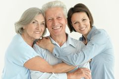 Family portrait of happy parents with adult daughter posing together stock photography