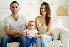 Happy parents and baby boy in living room royalty free stock photo