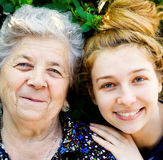 Family portrait - happy senior woman and daughter. Closeup portrait of happy grandmother and daughter Stock Photography