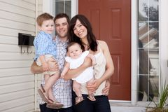 Family Portrait at Home. Portrait of a young family with mother, father, son and daugther stock photography
