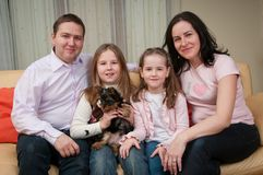 Family portrait at home. With two children and dog Royalty Free Stock Photos