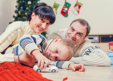 Family portrait at home under the christmas tree Stock Image