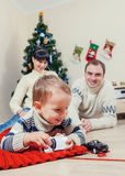 Family portrait at home under the christmas tree Royalty Free Stock Images