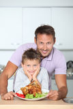 Family portrait in kitchen Stock Photography