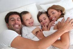 Family portrait laying in bed Stock Photo