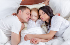 Family portrait laying in bed Royalty Free Stock Photography