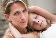 Family portrait, mother and daughter. Similar face of mother and daughter Stock Photos