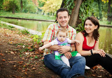Family portrait - mother father and baby daughter royalty free stock images