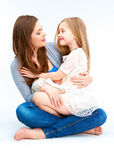 Family portrait. Mother huging daughter. White background Royalty Free Stock Images