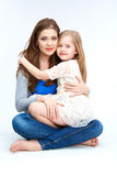Family portrait. Mother huging daughter. Stock Photos